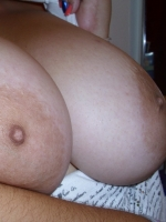 Chubby girlfriend shows off her huge tits as she lets her boyfriend take naked pictures of her