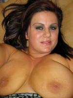 Chubby girlfriend takes selfshot pictures of her huge all natural tits spilling out of her top
