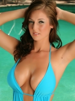 Busty Alluring Vixen tease Chenay shows off her huge boobs by the pool in a skimpy swimsuit