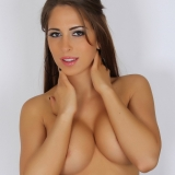 Busty Alluring Vixen Amber J teases with her big tits as she strips out of her semi sheer tube top
