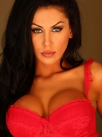 Busty Alluring Vixen babe Danielle shows off her perfect curves in her skimpy red lace bra and panties