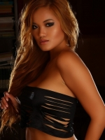 Stunning Alluring Vixen tease Jannie shows off her perfect body a skimpy little top that barely covers