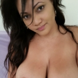 Chubby cute girlfriend shows off her huge natural tits as she gets topless for her boyfriend