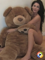 Watch as naked Alluring Vixen babe Danielle shows off as she poses with a giant teddy bear