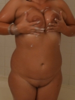 Chubby girlfriend lets her boyfriend take pictures while she takes a shower