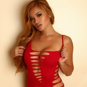 Alluring vixens: graceful alluring vixen tease jannie shows off in a tight skimpy red dress that barely covers her perky boobs.