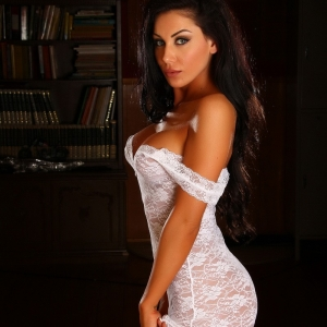 Alluring vixens: divine alluring vixen babe danielle shows off her perfect curves in a skin tight white lace outfit.