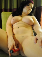 Chubby girlfriend strips naked and plays with a dildo for her boyfriend