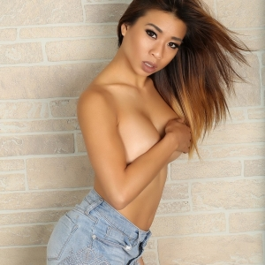 Alluring vixens: curvy asian alluring vixen tease annie shows off her big tits as she gets topless.