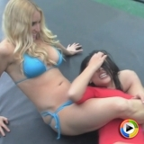 Watch as busty blonde bikini babe Deanna takes on the Asian beauty Azia