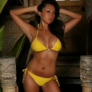 Busty Asian Alluring Vixen tease Hoshi is feeling tropical as she shows off her big boobs in a skimpy yellow bikini