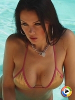 Watch as busty Alluring Vixen babe Erika G shows off her perfect curves in a skimpy string bikini as she poses in the pool