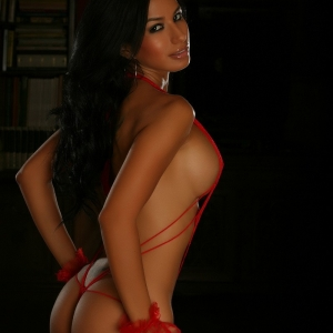 Alluring Vixens: Busty Alluring Vixen babe Liz shows off her perfect curves in very skimpy red lace lingerie