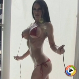 Watch as busty Alluring Vixen babe Jennifer teases in her very skimpy string bikini