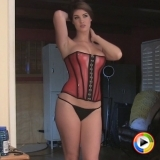 Watch as perfect Alluring Vixen Arielle shows off her curves in a very tight corset and a skimpy black g-string