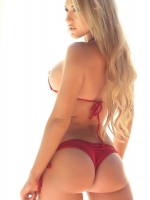 Stunning busty blonde Alluring Vixen babe Summer shows off her perfect round ass in a skimpy string bikini