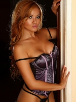 Stunning Alluring Vixen babe Jannie teases in her sexy lace and satin corset that barely keeps her boobs covered