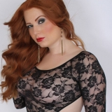 Curvy red head Alluring Vixens babe Chrissy teases in her skimpy lace bodysuit