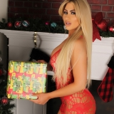 Curvy Alluring Vixen babe Melanie Ann is on the naughty list as she strips out of her skimpy dress