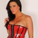 Busty Alluring Vixens babe Arian can barely keep her big boobs in her skin tight corset top