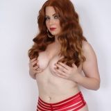 Curvy Alluring Vixens redhead Chrissy teases topless in just her red thong panties