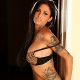 Tattooed Alluring Vixen babe Shay teases in her spike covered bra and matching black lace panties