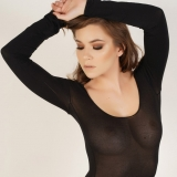Stunning Alluring Vixen babe Stephanie shows off her perfect body in a skimpy semi sheer bodysuit