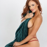 Fiery Alluring Vixen babe Maija teases with side boob as she poses topless with a blanket