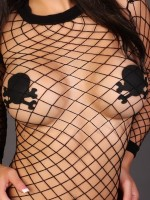 Kiras huge tits are just covered by skull pasties and a fishnet top