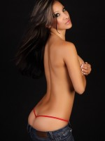 Alluring vixen Kira looks stunning as shes topless with just tight jeans and a red g-string