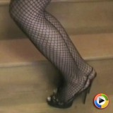 Sexy vixen Laura shows off her long sexy legs in fishnets