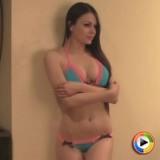 Alluring Vixen Ashley shows off in a tiny string bikini