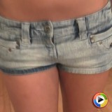 Alluring Vixen Candaces teases in a little sheer tube top and tiny jean shorts