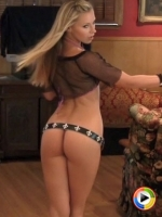 Alluing Vixen Lena Nicole poses for the camera in a very tiny shiney bikini