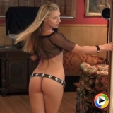Alluing Vixen Lena Nicole poses for the camera in a very tiny shiney bikini