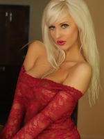 Busty blonde vixen Tara Babcock loves to tease in her sexy red lace outfit