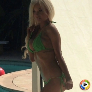 Alluring Vixen Krystal poses for pictures outdoors in a very skimpy green bikini that looks amazing on her tight little ass