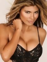 Alluring Vixen Claudia teases in her black lace lingerie outfit that barely covers her big juicy breasts