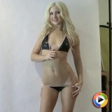 Watch the stunning blonde Ashlie in her skimpy string bikini that barely covers her perfect body