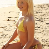 Sexy blonde Ashlie is at the beach in a crochet string bikini that barely covers her perfect curves