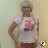 Sexy Alluring Vixen Tara Babcock shows off in a tight I Heart Tara Babcock shirt and cute pink panties with her hair in pigtails