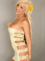Perfect alluring vixen kimmy shows off her dangerous curves in a lascivious little yellow lace dress that barely can contain her huge tits