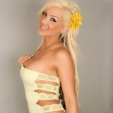 Perfect Alluring Vixen Kimmy shows off her dangerous curves in a sexy little yellow lace dress that barely can contain her huge tits