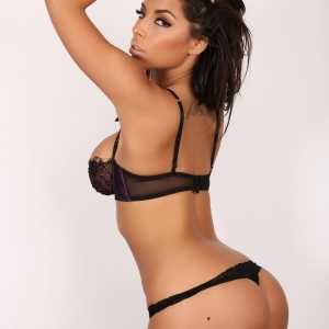 Alluring Vixens: Busty Alluring Vixen Charm shows off her perfect round ass in a sexy little black lace bra and panties