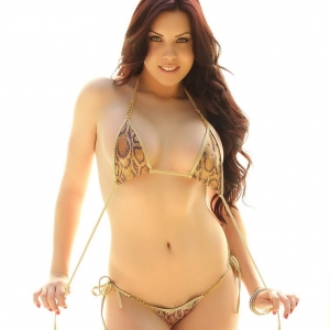 Alluring Vixens: Alluring Vixen Aura shows off her perfect curves in a snake skin string bikini that barely covers anything