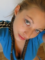 Cute teen in braids takes selfshot pictures of herself for her boyfriend
