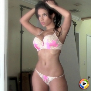 Watch as busty Alluring Vixen Charm shows off her perfect round curves in a sexy matching lace bra and panties