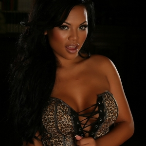 Alluring Vixens: Sexy busty Alluring Vixen Melanie Elyza shows off in a sexy leopard print corset with matching skirt