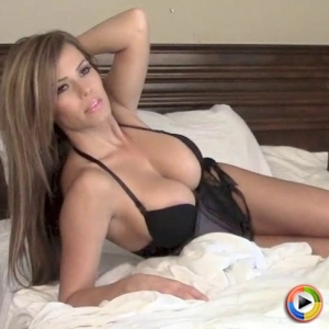 Alluring Vixens: Watch as busty Alluring Vixen babe Candace shows off in bed in a very lowcut tight corset that barely can contain her big juicy tits