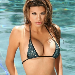 Alluring Vixens: Alluring Vixens busty babe Claudia is in the pool in a skimpy string bikini that barely covers her perfect curves